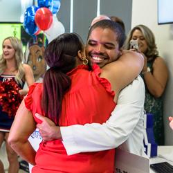 Alvarez Hugs His Mother at the Ceremony