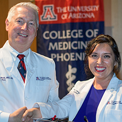 Dean Reed with Kristina Yancey at the White Coat Ceremony