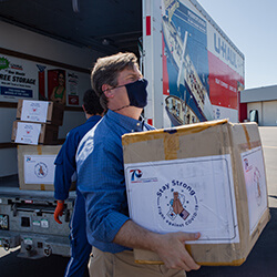 U.S. Representative Greg Stanton Helping to Load Supplies