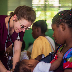 Merrion Dawson Works with a Patient During a Global Health Trip to the Dominican Republic