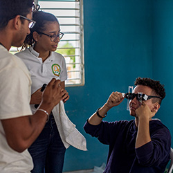 Medical Students Performing an Eye Exam