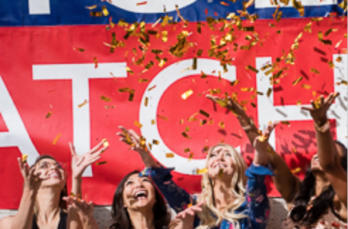 Four Medical Students Toss Confetti in the Air at Match Day