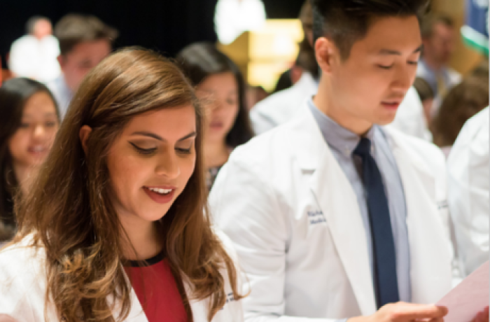 Medical Students Recite Their Class Oath at the White Coat Ceremony