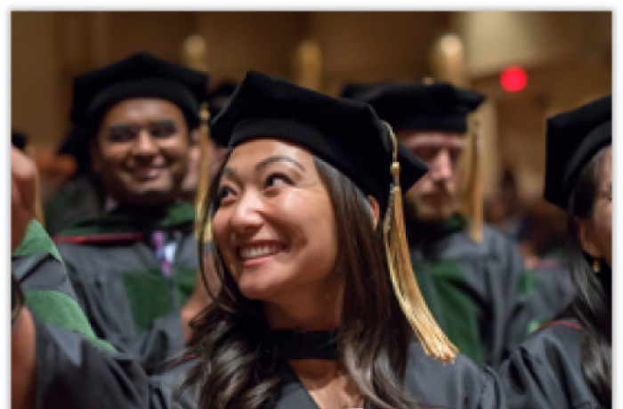 A Medical Student Smiles in Her Cap and Gown at Commencement
