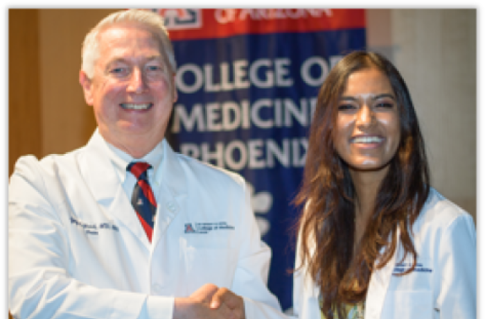 Dean Reed Shakes Hands with a Medical Student