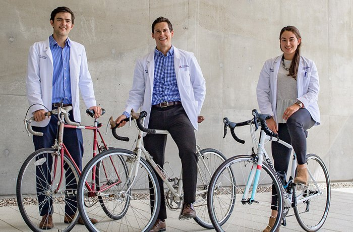 Medical Students Outside of HSEB with Their Bikes
