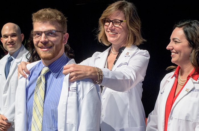 Student Donning His White Coat at the White Coat Ceremony