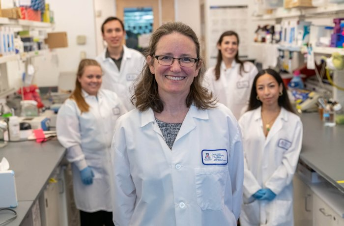 Dr. Taben Hale in Her Lab with Her Research Associates
