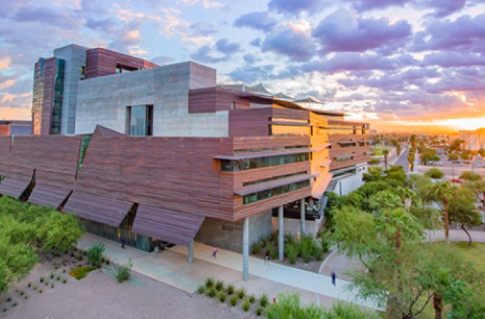 image of health sciences education building at sunrise