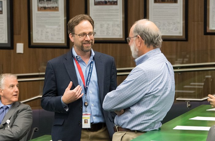 Dr. Knox Talks with Another Faculty at the General Faculty Meeting