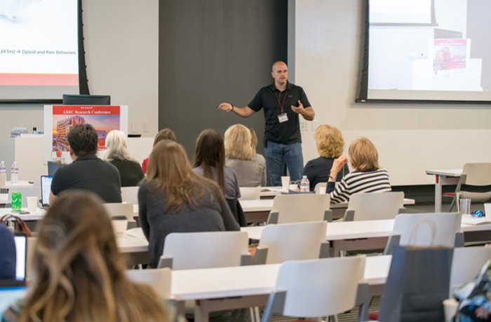 A Man Lectures a Group at the ABRC Research Conference