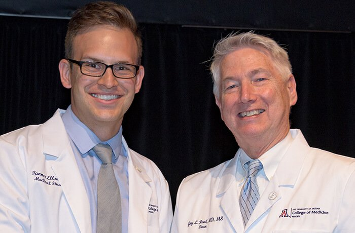 Tanner Ellsworth with Dean Reed at the White Coat Ceremony for the Class of 2021