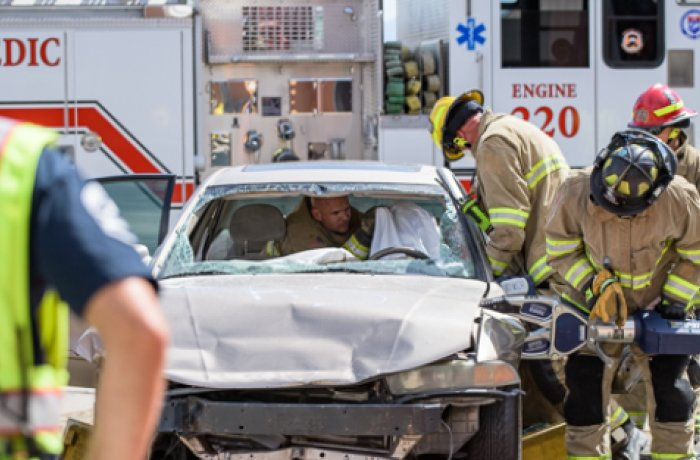Firefighters Work the 'Jaws of Life' on a Damaged Motor Vehicle