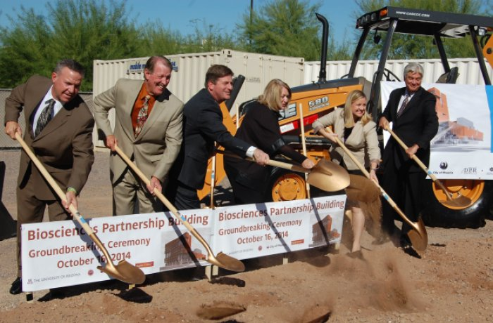 Leaders shoveling dirt at groundbreaking