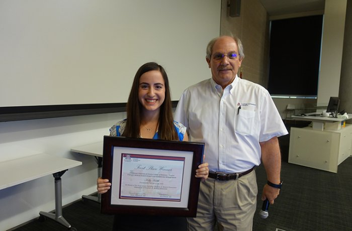 Medical Student Kelly Habib Holds Her Award with Dr. David Beyda
