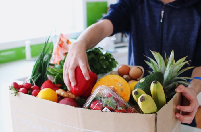 Box filled with fruit and vegetables