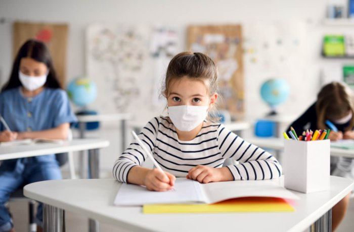 Young Students in Masks in the Classroom Setting