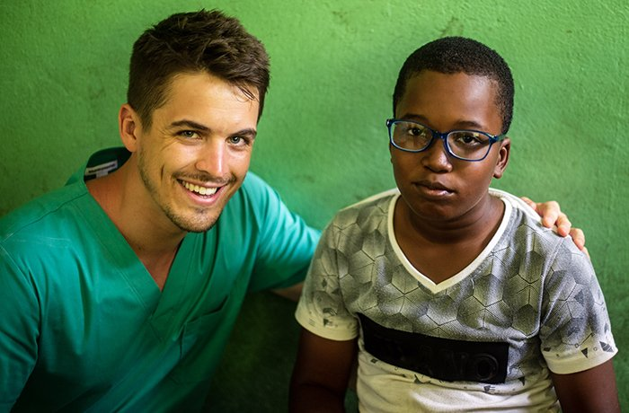 Medical Student Scott Litton with a Patient in the Dominican Republic