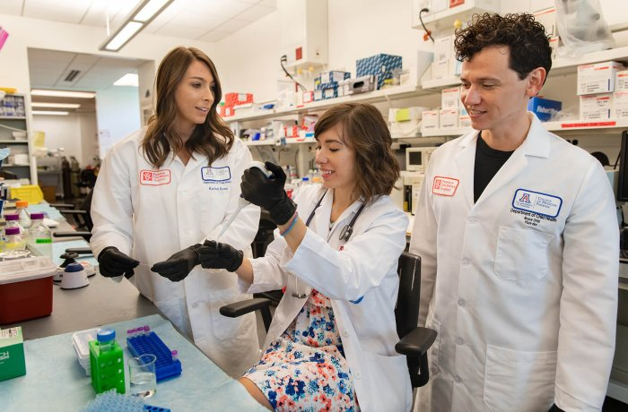 Rachel Rowe, PhD, Alona Sukhina, MD, and  J. Bryce Ortiz, PhD, Working in the Lab