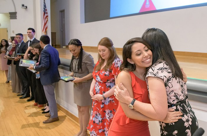 Graduating Pathways Student, Abigail Solorio, Hugs Dr. Maria Manriquez at the Ceremony