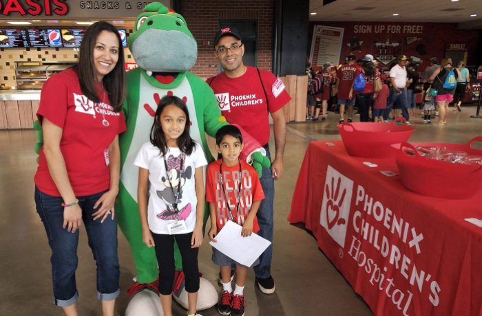 Dr. Rastogi and family at a Diamondbacks game volunteering for Phoenix Children's Hospital