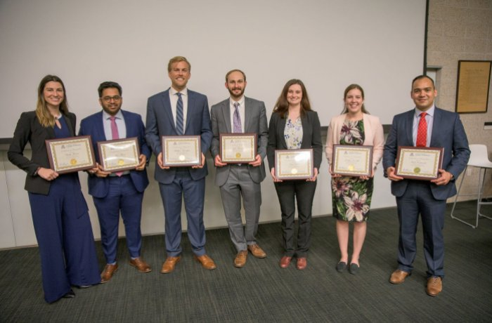 Medical Students Hold Up Their Awards at the Annual Student Research Symposium