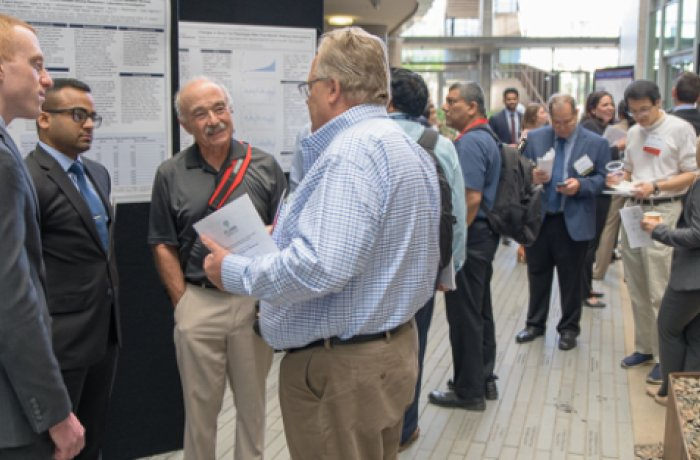 candid shot of group at the annual student research symposium