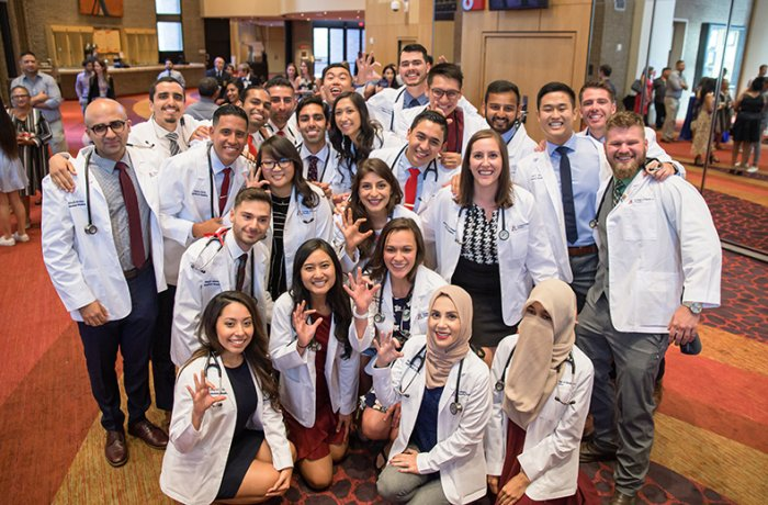 Medical Students from the Class of 2023 Pose for a Group Picture in the Lobby of Symphony Hall