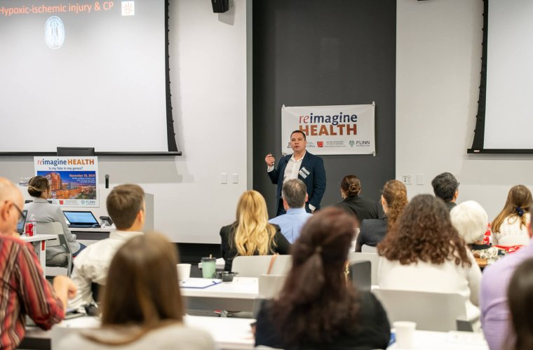 Michael Kruer, MD, Speaks at the 2019 reimagine Health Research Symposium