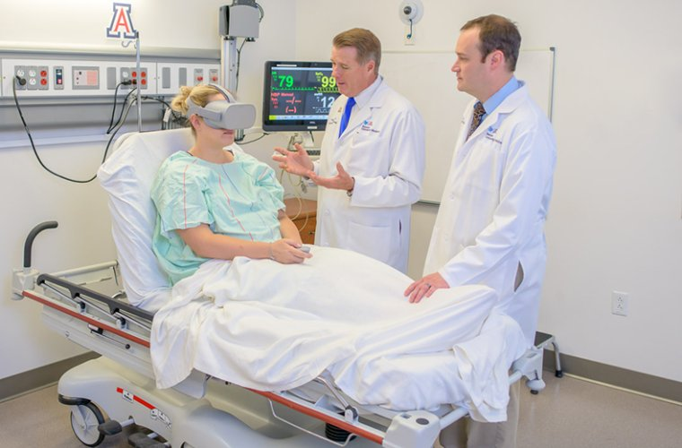 Dr. Foley Explains Virtual Reality Equipment to Patient