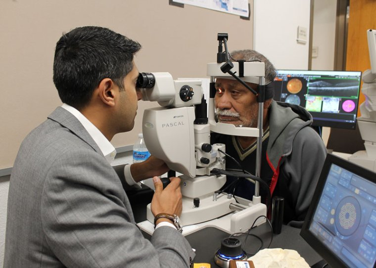 Dr. Amit Sangave performs eye exam. Photo courtesy of St. Vincent de Paul.