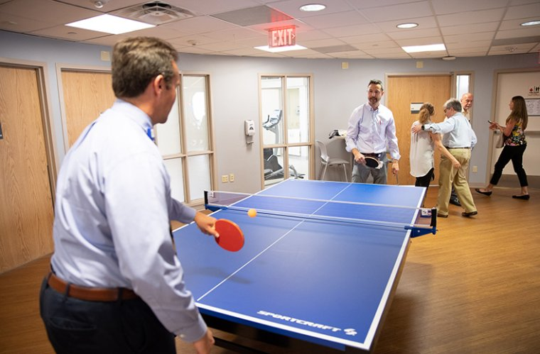 Dr. Steven Brown Plays Ping Pong with a Resident
