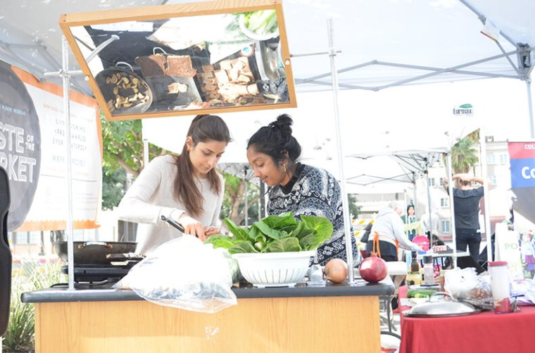 First-Year Medical Students Leeann Qubain and Sukriti Bagchi Cooking at the Market