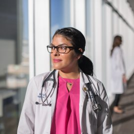 Former Medical Student Mia Wright Looks Out of a Window